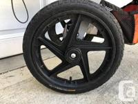 Comes with Continental Kevlar tires($175), rain shield