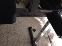 Like new Body Solid decline bench. No damage, rips or