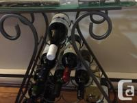 Beautiful metal wine rack with bevelled glass top from