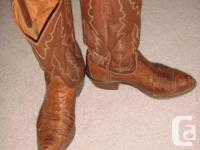 Brown/rust leather, with alligator design on toes. Oval