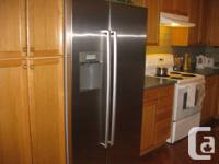 new stainless steel Bosch fridge/freezer for sale