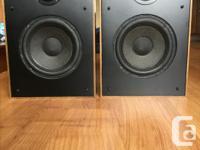 Pair of Boston acoustics A60 speaker in walnut finish.