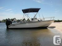 VERY CLEAN LOW HOUR 2003 BOAT. 135 H.P. MERCURY OPTIMAX