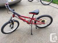 Red boy's bike, made by Shimano. Suitable for a boy
