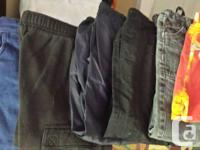 several pairs of pants, a couple coats and hats,