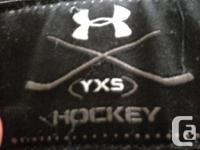 Performance gear with velcro to hold up hockey socks.