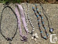 5 new pendants,.  1. Black with removable beads and