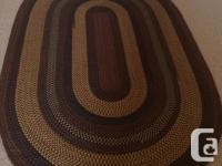 Beautiful 6'x9' 100% wool braided area rug purchased in