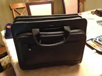 Black, leather laptop bag for sale. Perfect for office