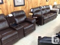 Brand new bonded leather reclining Loveseat with Center