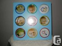 First year baby pictures. Wooden frame. Holds 9