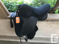 Beautiful and brand new 17.5 inch seat dressage saddle.