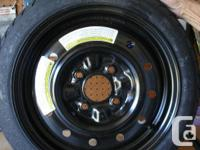 """Brand new spare tire, never been used, on 15"""" rim"""