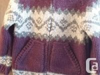 Handknitted sweater with a hood and kangaroo pockets on, used for sale  British Columbia