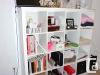Brand new Ikea cubby shelf. It's the glossy white,