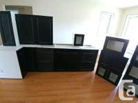 Dark wood cabinetry (with matching high top dining