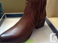 Still in the box. Gorgeous two-tone brown color with