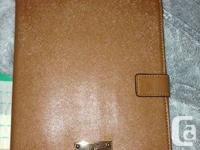 I am selling my brand new leather michael kors case for