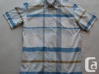 This Quiksilver plaid short sleeve shirt is brand new