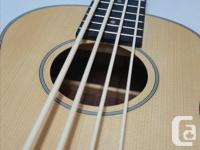 Brand new, out of box. 30-inch Spruce top,