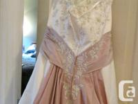 Brand new wedding dress for sale. Cream color with