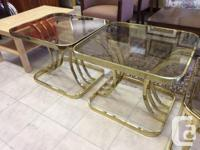 We have a coffee and 2 end tables with a brass finish