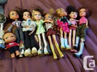 8 bratz dolls including a baby bratz Lots of brushes