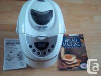 Includes instructions and a recipe book.  Black and