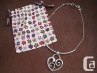 This wonderful Brighton pendant has a quite linked