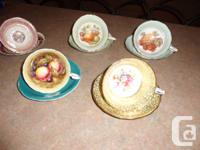 1 pink white and gold mug and dish made by Stanley