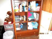 This is a nice armoire with shelves, a side door with