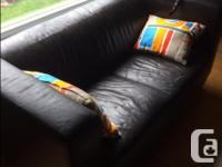 Well used, high quality brown leather couch. Some light
