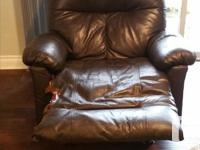 Quite new brown leather recliner/rocker slightly tasted