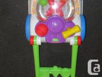 Push 'mower' bubble popper with music by Fisher Price.