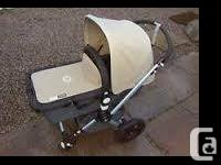 At the top of the strollers . Bugaboo chameleon grey