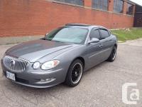 Make. Buick. Design. Allure. Year. 2009. Colour. Grey.