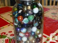 For sale are 6 jars of marbles as shown in the