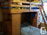 Bunk Bed with drawers for storage and a desk. Clean