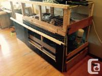 For sale a custom-made trilevel rabbit enclosure with
