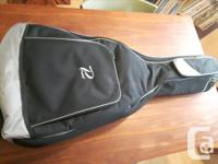 Burswood acoustic guitar and gig bag. Has a few dings,