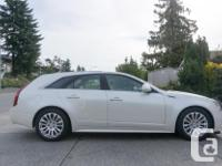 Make Cadillac Model CTS Wagon Year 2010 Colour White