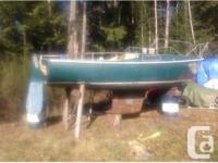 Cal 20'. Can sleep 4 adults, solid little boat. Great