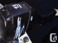Has a 2013 15 hp 4 stroke with throttle & electric