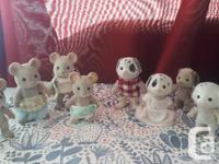 2 well loved Calico Critter families. Two adult mice,