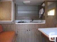 A 8 foot camper on u,trailer gas stove,fri pull out 2
