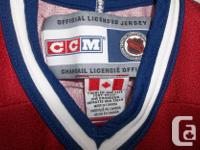 """In mint condition! CCM hockey jersey """"Canadian"""" Size"""