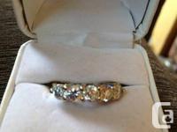 Ladies size 8. Canadian Maple Diamonds. 14K yellow