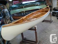 Vintage 16' Huron wood canvas canoe. First Nation's