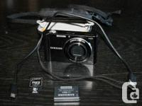 For sale:  Two point and shoot digital cameras with