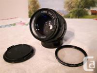 I have two of these lenses, so one must go. Canon FD